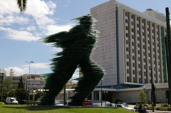 Hilton Athens: Sculpture with Hilton in Background