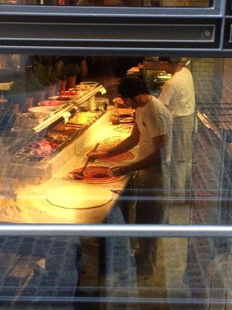 L'Osteria : Pizza being prepared fresh