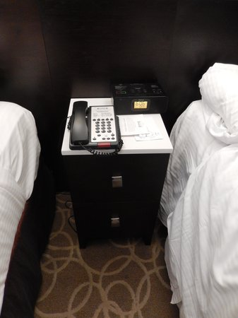 Staybridge Suites Times Square - New York City : bedside cabinet and phone