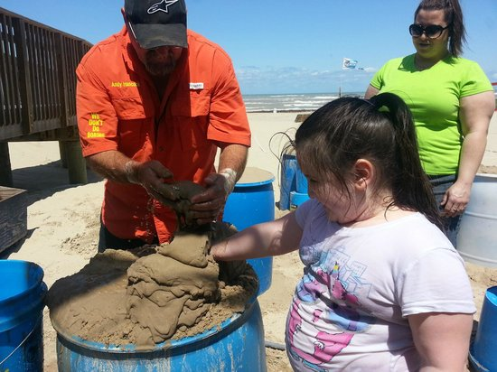 Sandcastle Lessons: Our youngest finding out just how sand binds with water..lol