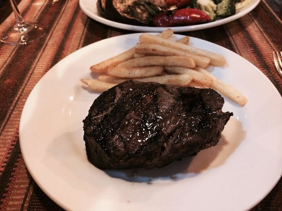 Patagonia Restaurant: Filet with fries. Perfectly cooked. They claim it was 8 oz, but much bigger.