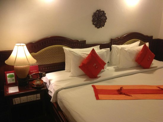HanumanAlaya Boutique Residence: Very comfortable bed with classic designed phone