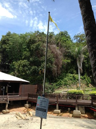 Century Langkawi Beach Resort: tattered flag and rusty sign may seem small but set tone.