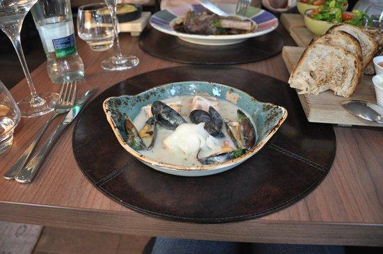 Kitchen & Table Bergen: Top: Uncle Denk's Lamb Shank, Bottom: Sailor Coya's Fish Pot