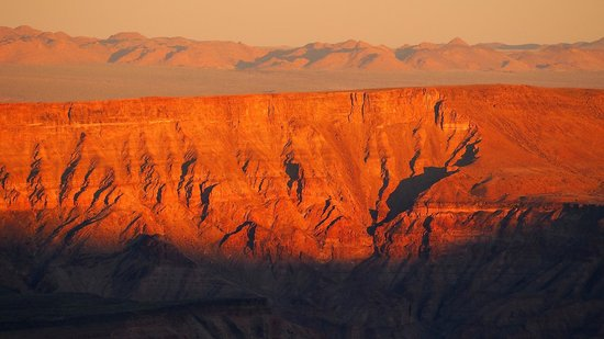 Fish River Lodge : Sunrise over the canyon, you will need to be up and in position by 6pm for this.