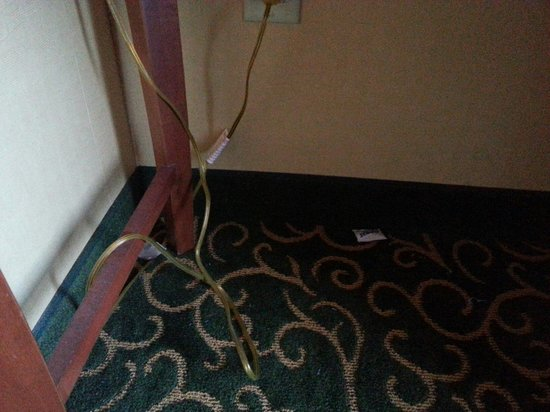 Embassy Suites by Hilton Hampton Hotel Convention Center & Spa : Sugar packet and garbage left under desk upon arrival.
