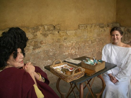 The Roman Baths: Patrician lady and slave discussing beauty regimen