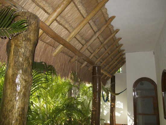 Posada Yum Kin: Thatched balcony overhang of ground patio