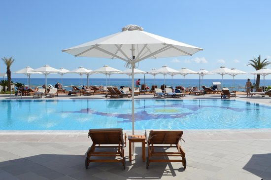 Sensimar Lindos Bay Resort & Spa: seaside view with pool area