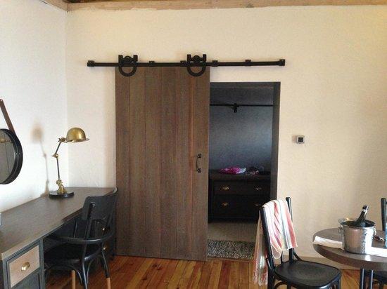 Flamm: Cool door in hotel suite, into massive closet.