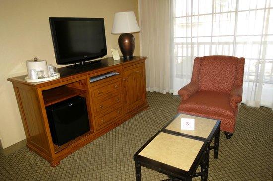Pacifica Suites Santa Barbara: The credenza with TV and fridge