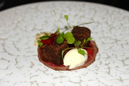 Purnell's: Carpaccio of beef - red wine octopus - home cured beef - salt beef - sour cream - sweet and sour