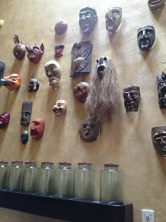 Andean Wings Boutique Hotel : decorative masks on the lounge/bar area wall