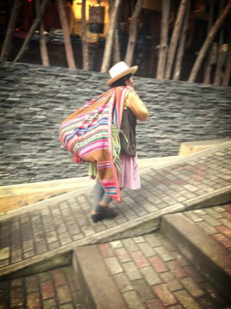El MaPi by Inkaterra: Traditional woman on street outside hotel