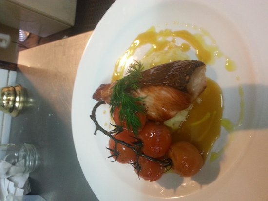 Fresh: Panfried Salmon fillet , creamy garlic mash with confit vipe ripe tomatoes and a saffron burre b