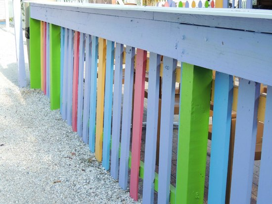 RC Otter's Island Eats: colorful fence near outdoor seating