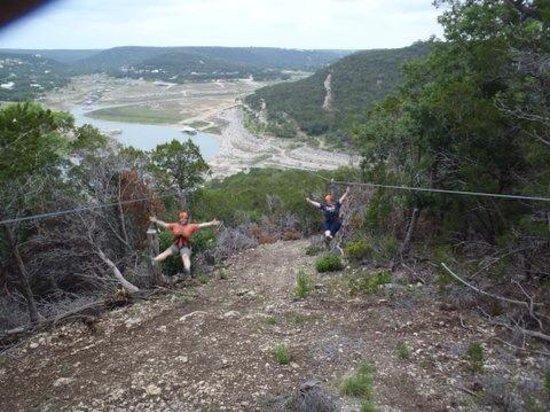 Lake Travis Zipline Adventures: My friend K and I racing on the last zip