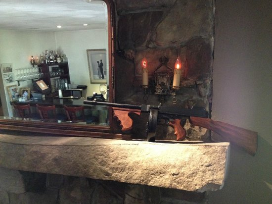 """High Point Restaurant: Scale replica of a """"Capone"""" machine gun on the mantle"""