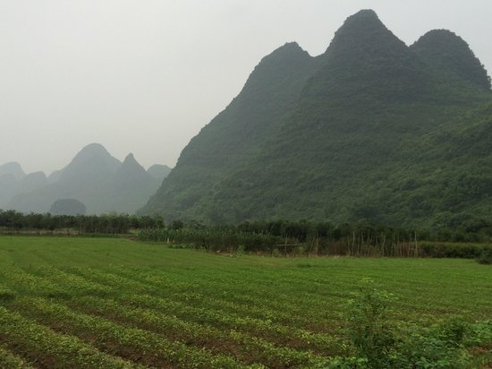 Yangshuo Bethlehem Hotel: Opposite river is a mountain area with farming community. A tranquility sensation