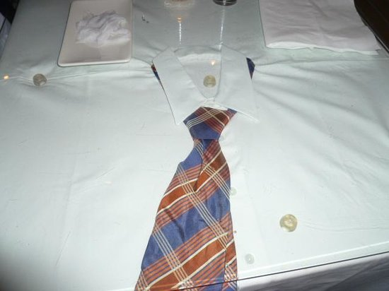 Rakang: This is the quirky table top decor. A shirt and tie under glass.....cute!