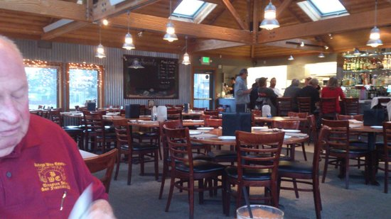 Johnny's Harborside : dining room with a board of the 'fresh catch' on the wall