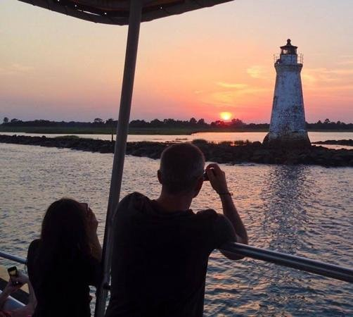 Captain Mike's Dolphin Tours : Cockspur lighthouse at sunset