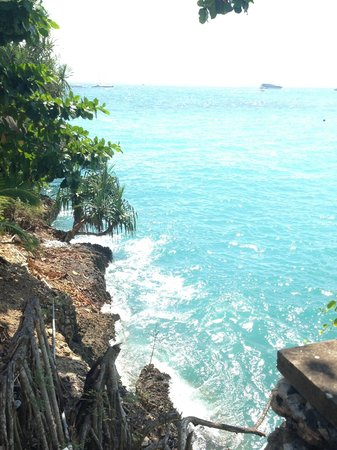 Watching waves come in along Sadeg's small cliff