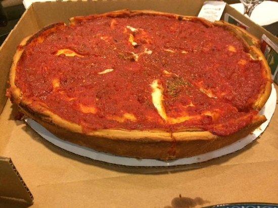 Patxi's Chicago Pizza: 23 dollari per questa pizza, il formaggio è sotto il pomodoro. Ottima per 4 persone.