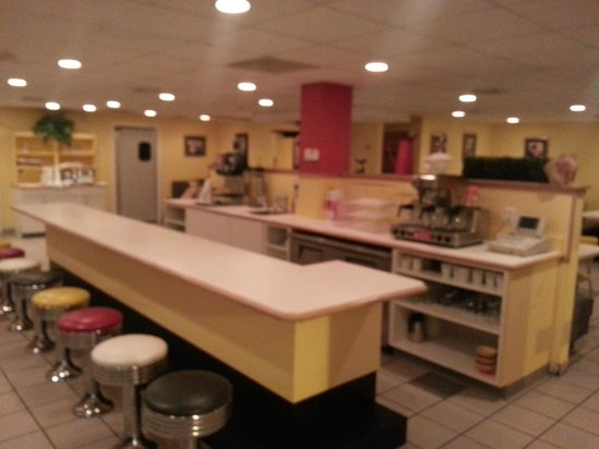 The Waves Restaurant: booths and tables surround this huge counter!