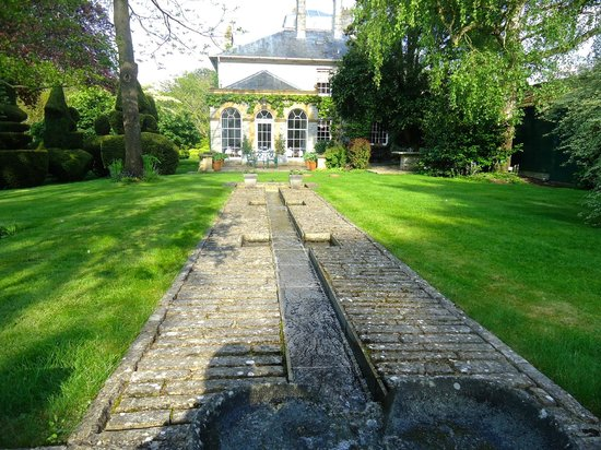 The Lynch Country House: The garden's rill water-feature looking towards the breakfast room