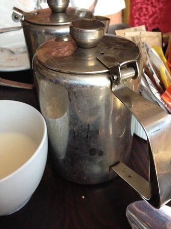 Jolyon's at No. 10: filthy tea pot & note the milk served in a cup (no milk jugs)