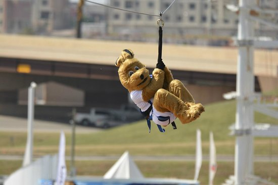 Oklahoma City Boathouse District: Splash, the RIVERSPORT Mascot, rides the SandRidge Sky Zip.