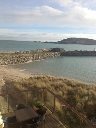 Overlooking beach and harbour walls