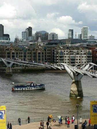 View of the Millennium Bridge over the Thames from a balcony in the Tate Modern.
