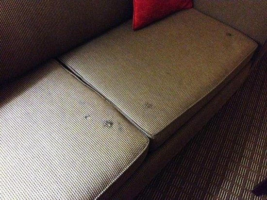Comfort Suites Clayton: Furniture in our room, looks bad in person and the rug is sticky