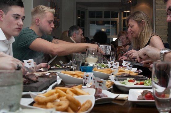 Seattle SteakHouse Restaurant: Family Enjoying Their Meals