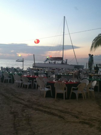Couples Swept Away : Setting up for the Beach Party