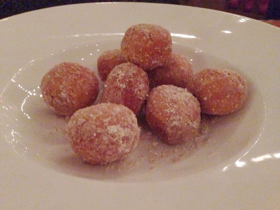 Zeppole Coastal Italian: Zeppole - Italian pastry consisting of a deep-fried dough ball dusted in sugar and served with c