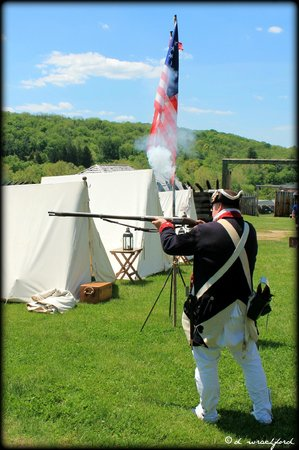 Fort Ligonier: reenactment of soldier shooting a musket