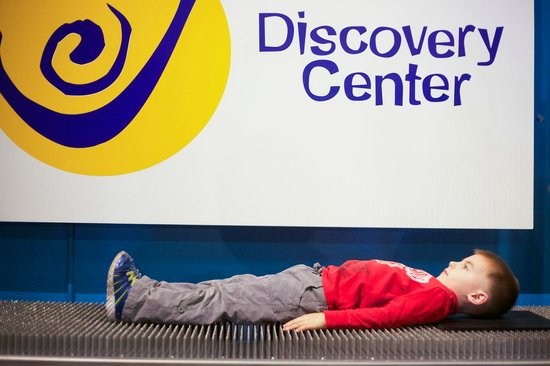 Discovery Center of Springfield: Bed of Nails.  How many nails can you lay on?