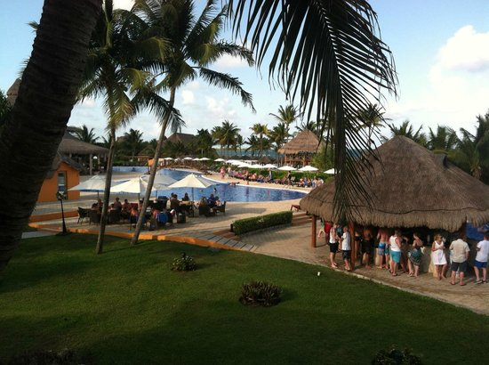 Ocean Maya Royale: Left is quiet pool, bar, then active pool on right