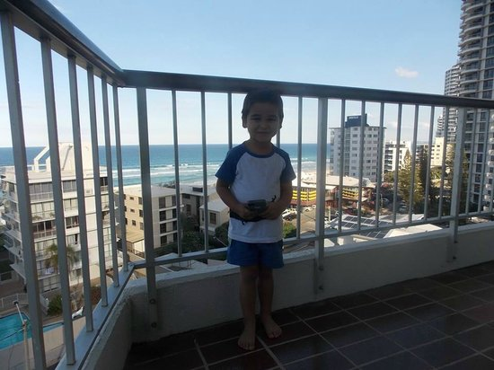 Surfers Beachside Holiday Apartments: My son the day we arrived! He was happy with the view!