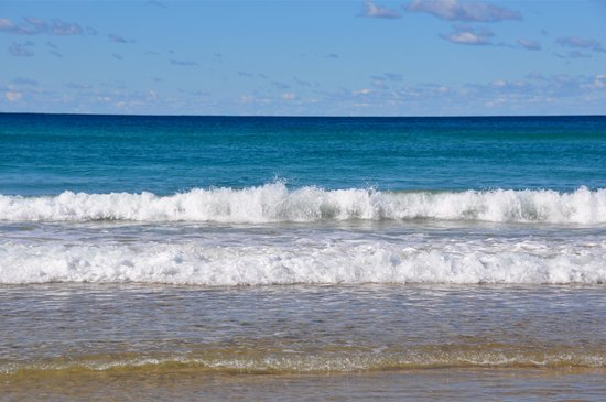 Blue sky clean blue ocean pristine golden sand what more could you