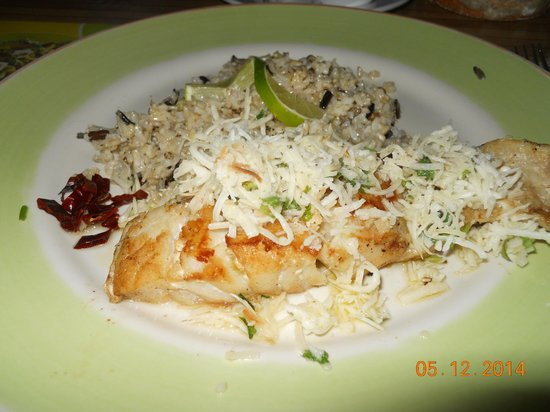 100% Natural: coconut topped fish with brown rice