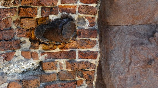 Fort Sumter National Monument: Artillery shell still embedded in wall of the fort