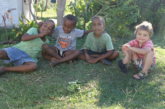 Blue Lagoon Beach Resort: Visit to Nacula Village. My son meeting the local children.