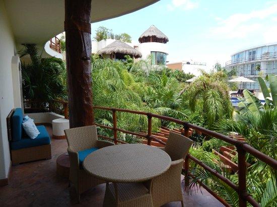 Porto Playa Condo Hotel & Beachclub: Balcony, garden trees, partial view of the pool