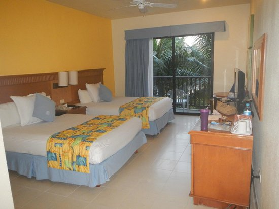 The Reef Coco Beach: room, with palm tree outside