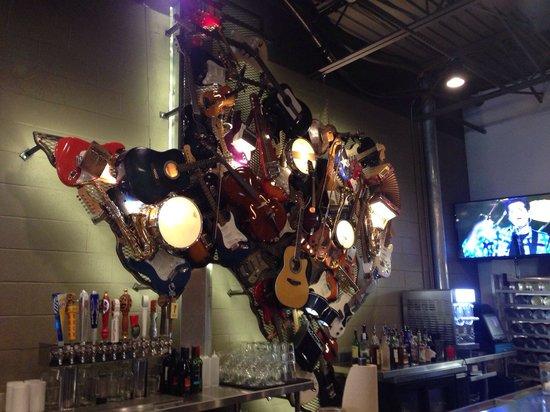 LSA Burger Co: Texas made out of various instruments at the bar.