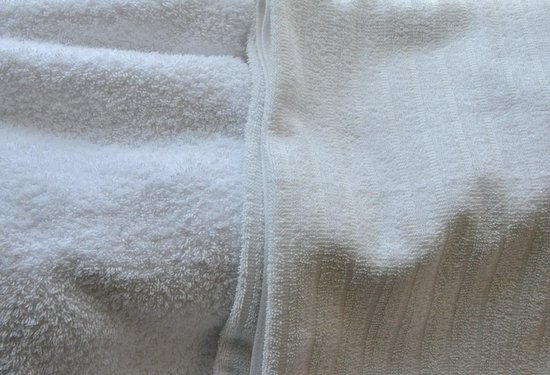 TownePlace Suites Dallas Arlington North: We received towels like those at left days 1 and 2. Day 3, we received lower quality towels.